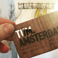 Wooden business card for tum.amsterdam