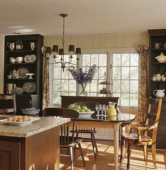 tall bookshelves in dining area flanking patio doors...maybe do breakfronts with storage at bottom.