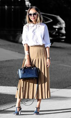 46da60549db6 Fashion Blogger on the rise Queen Horsfall rocks the coolest pair of heels  and chic pleated