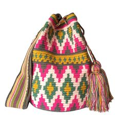 $83.00-$91.00 USD. Each #Wayuubag is one of a kind and has taken from 15-20 days to make, each make has been crafted with love in the desert of La Guajira, Colombia. www.lombiaandco.com
