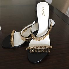 New black and gold sandal heels Brand new never used and still in original box.  SIZE DETAILS Heel Height(cm):5  DESCRIPTION Color:Black and Golden US Size:8 Decoration:Rhinestone Shoes Sandals