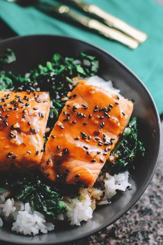 This recipe will change your life. Topped with a lime infused maple syrup and pepper flake sauce and sprinkled with black sesame seeds, this Asian Salmon and Spinach Rice Bowl recipe is packed with fl