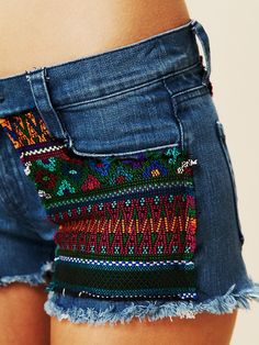 Denim shorts with multicolor woven patches on front and back