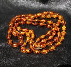 Faux Whiskey Amber Necklace 54 Inches Long Vintage Single Double or Triple Strand by ElegantArtifacts on Etsy