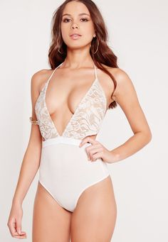 This white hot lace plunge neck bodysuit is hot on our wishlists right now! Featuring a nude contrast underlay, popper buttons at fastening and a tie strap fastening at neck; we're lovin' this. Wear with a pair of high waisted jeans and a c...