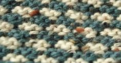 Close up of easy-to-knit houndstooth where tweed nubs are really visible.