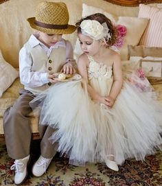 Ivory flower girl tutu dress. little gentleman with vest and hat.