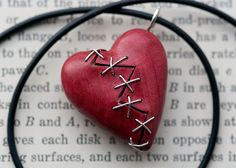 Hey, I found this really awesome Etsy listing at https://www.etsy.com/listing/203648009/stitched-heart-pendant-hand-carved-in
