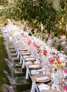 Ghost Chairs With Hot Pink Peony Centerpieces | Photo: Gayle Brooker Photography | Flowers: Nancy's Exotic Plants
