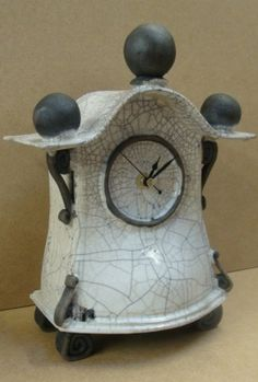 Ian Roberts-Raku Ceramic Clock. I like the shape.. But not the raku on this piece...