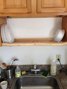 Hang a dish rack over the sink.