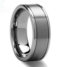 The Dynasty Mens Wedding Band rules all the classic looks. This matte tungsten wedding band has a 5mm strip of brushed tungsten running through the otherwise mirror finished ri