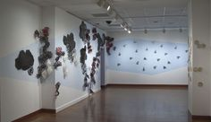 Pixley Young, Alice - Cloud Wall (installation view), 2009, tar paper, thread, paint
