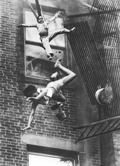 1975 - A mother and her daughter are hurled off a collapsing fire-escape in an apartment house fire in Boston. (Stanley Forman)