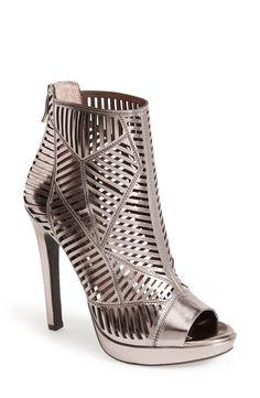 Wearing these metallic caged platform sandals to girl's night!