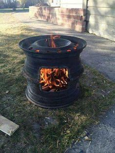 DIY Wood Stove or Outdoor Fireplace - Can't find the original source but would l. DIY Wood Stove o Rim Fire Pit, Wheel Fire Pit, Fire Pits, Diy Wood Stove, Rims For Cars, Old Tires, Welding Projects, Welding Art, Metal Welding