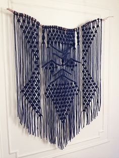 """THIS INDIGO BLUE MACRAME WALL HANGING IS MADE ON A DRIFTWOOD BRANCH. THIS MODERN BOHEMIAN ROPE ART WALL HANGING ADDS A PERFECT TOUCH OF TEXTURE AND COLOR TO ANY SPACE. DIMENSIONS: 3'-6"""" WIDE X 5' HIGH    FOR PRICING CLICK HERE  , FOR CUSTOM COLORS, ORDERS AND INQUIRIES PLEASE USE THE CONTACT FORM."""