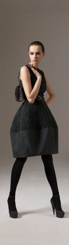 circle skirt of med-heavy with a straight cut piece on bottom. Love the effect : )