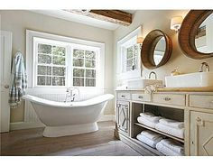 Cute bath, love the tub & barrel mirrors  Vintage Farmhouse: Nicola Manganello