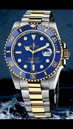 Rolex Oyster Perpetual Date Submariner 300m. Blue and gold bezel with blue dial. Gold and steel wristband.