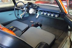 The interior is spartan, with rows of gauges stretching across the dash, two close-set seats, and...