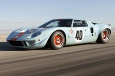 The Ford which is the company's famous race car, won the Le Mans car race 4 times in succession. This is a 24 hour race. Ford Gt40, Most Expensive Car Ever, Expensive Cars, Ford Transit, Sports Car Racing, Sport Cars, Auto Racing, Image F, Ferrari