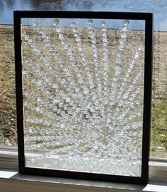 Glass on glass. An old picture frame decorated with glass gems.
