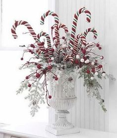 Check out this collection of 36 Impressive Christmas Table Centerpieces and find how to decorate your holiday table. Tie red-and-white peppermint sticks around a vase with a.use candy canes in centerpiece. great idea for the kids table at Christmas d Noel Christmas, Winter Christmas, All Things Christmas, Christmas Wreaths, Whimsical Christmas, Beautiful Christmas, Outdoor Christmas, Primitive Christmas, Christmas Morning
