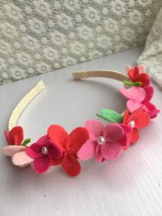 This beautiful headband with pink shade felt flowers placing on the side is absolutely stunning and comfortable to wear. The plastic headband is Felt Flower Wreaths, Felt Flowers, Baby Flower Headbands, Handmade Felt, Girls Bows, Felt Crafts, Absolutely Stunning, Hair Bows, Pink