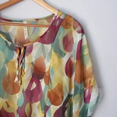 Sheer flowy top Gently worn- excellent condition! Big boho sleeves. Elastic at bottom. Lovely spring colors!  Bundle for best deals!! Hundreds of items available for discounted bundles- items starting as low as $5! You can get lots of items for a low price and one shipping fee!  Follow on IG: @the.junk.drawer andree Tops