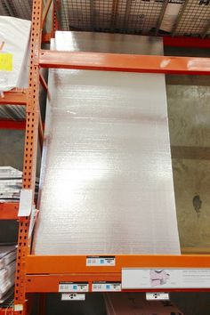 Home Depot - Foil sound barrier styrofoam panels............................... styrofoam insulation with sound barrier foil on them. They are 4' wide by 8' tall, weigh about 3 pounds each, and are only $10.00 a panel.