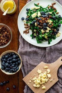 This Kale Salad with Blueberries, Manchego and Pumpkin Seed Clusters by Healthy Seasonal Recipes is loaded with superfoods and is dairy-free and grain-free.