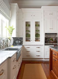 Kitchen White Cabinets. Wood Floor. Glass Door Cabinet with Green Accent Dishes. Pretty Window Treatment. Kitchen Trends for 2013 - Traditional Home®