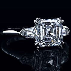 A modern 3 stone asscher cut diamond ring.