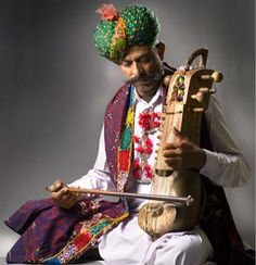 """""""The 'Sindhi Sarangi' used by the Langas of Rajasthan, is played on the four main wires, with more than twenty vibrating sympathetic strings."""