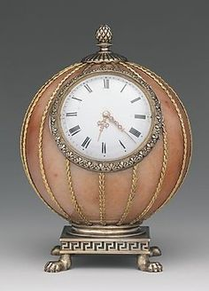 Fabergé--Spherical Clock--Before 1899--  Workmaster: Mikhail Evlampievich Perkhin (St. Petersburg)--Rose jasper, silver, silver gilt, gold, enamel  glass--The Metropolitan Museum of Art.  Height 3-7/8""