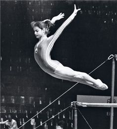 Nadia Comaneci is famous for being the first gymnast to achieve a score of perfect 10 in Olympics. Here are 10 interesting facts about this Romanian gymnast. Gymnastics History, Gymnastics World, Sport Gymnastics, Artistic Gymnastics, Olympic Gymnastics, Olympic Sports, Rhythmic Gymnastics, Olympic Games, Nadia Comaneci Perfect 10