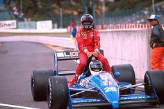 Stefan Johansson gives Gerhard Berger a lift at the 1988 Japanese Grand Prix