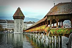 Lucerne, Switzerland. BEEN THERE! Walked through that bridge, beautiful paintings attached to the trusses.