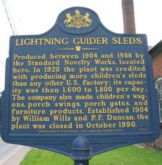 Lightning Guider Sleds historical marker in Duncannon, PA. Text: Produced between 1904 and 1988 by the Standard Novelty Works, located here. In 1920 the plant was credited with producing more children's sleds than any other U.S. factory; its capacity was then 1,600 to 1,800 per day. The company also made children's wagons, porch swings, porch gates, and furniture products. Established 1904 by William Wills and P.F. Duncan, the plant was closed in October 1990.