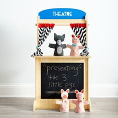 """Shop What's That Stand For?.  We like to think of this stand as TBSWELOEO (which stands for """"The Best Stand We've Ever Laid Our Eyes On"""").  It's multipurpose, so kids can use it for selling lemonade, making puppet shows and more."""