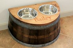 Dog food holder and bowls made out of a wine barrel. @sylvia Rodriguez - this would be cute for aunt Sarah to have for Gus!