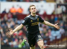 Jordan Henderson celebrates scoring Liverpool's equaliser against Aston Villa.