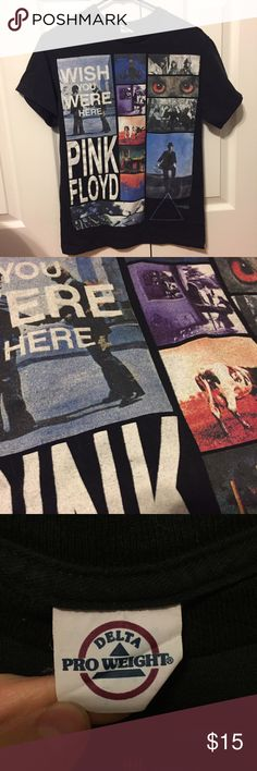 ✨Pink Floyd Wish You Were Here T-Shirt✨ Wonderful black tee from Pink Floyd with white writing and various album art. Relics, Ummagumma, Atom Heart Mother, Animals, More, Obscured by Clouds, PULSE, Division Bell, Dark Side of the Moon. Worn previously,  very soft and comfortable. Not many signs of wear besides tag.  Consider looking at the rest of my store, I have a 20% bundle discount and consider most good offers! Delta Shirts Tees - Short Sleeve