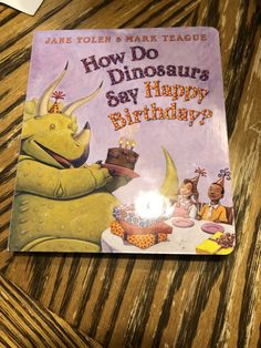 How do dinosaurs say happy birthday book Dinosaur book First birthday dinosaur ideas Have each guest sign the book at the party