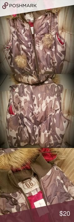 ☆ROUTE 66 Puffer camo vest w/ hoodie+fur☆ 💋Super cute ROUTE 66 puffer camo vest, hoodie has for as well as furry pom-pom's on ends of drawstring. Purchased at a boutique in CONCORD, CA.(..u can see it still has boutique tags on it!).. an never got around to wearing it!! Needs a home to be worn & not sit in my closet!! Route 66 Jackets & Coats Puffers
