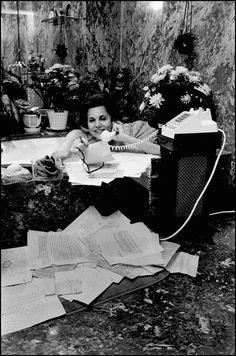 This is how I write all my books. In the tub, surrounded by flowers, just gabbing on the phone.    (Really, it's advice columnist Ann Landers. 1974, courtesy of Slate.)