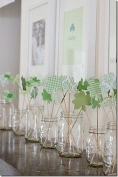 cute st. patrick's day mantel...would make cute garland. Would love these in milk glass vases!