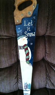 Snowman painted on saw