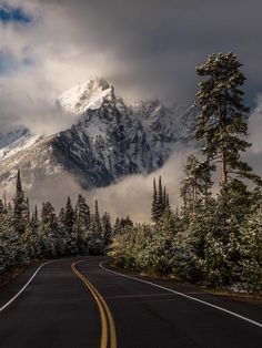 Grand Teton National Park in Wyoming with curling clouds and snow-dusted peaks. Photographer Eric Adams